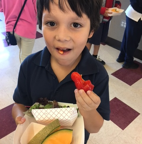 student eating fruit