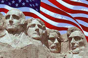 Mount Rushmore with the American Flag in the background