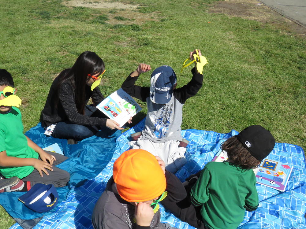 Students reading on grass