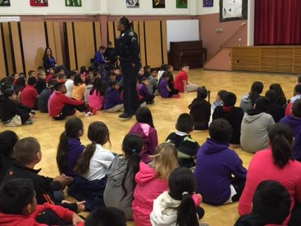 Corporal Murphy met with the students and talked about safety in school and in  the community. In the end of the assemblies, back packs were distributed to all  students. Big Thanks to Costco and Genentech for the donations!
