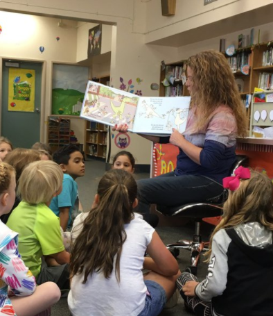 teacher reading to children