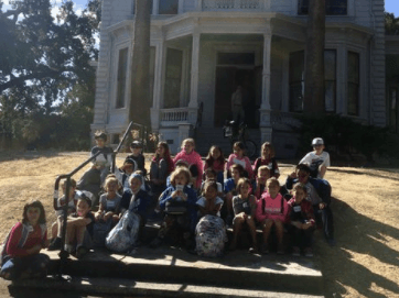 John Muir elementary school students and teacher sitting in front of the John  Muir house