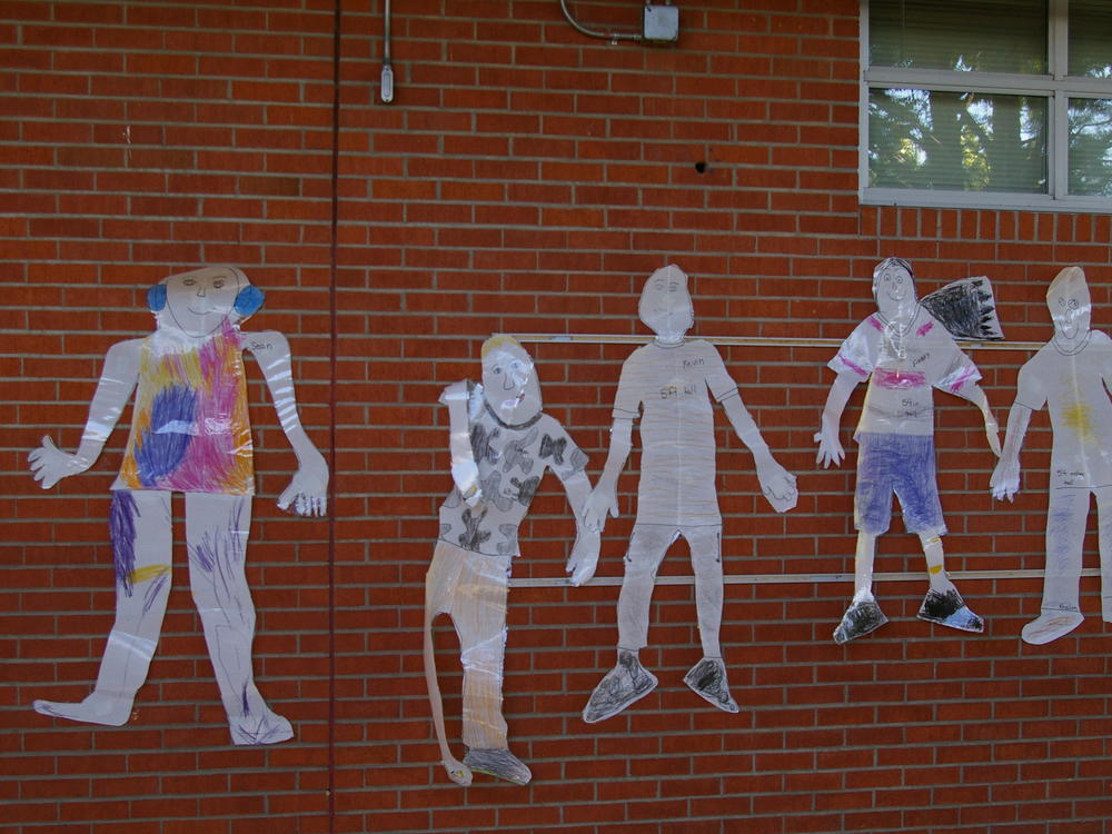 Paper figures on wall