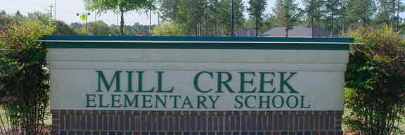Mill Creek Sign in the spring