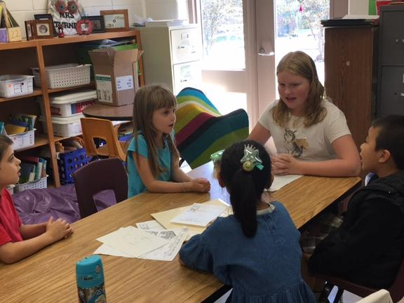 Fifth graders come to share with first graders