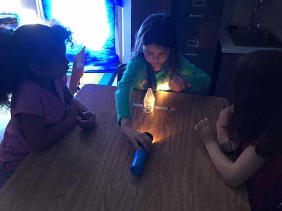 Students explore the properties of light