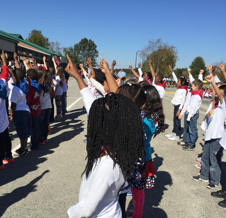 2nd grade performs for our Veterans