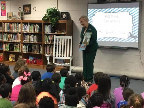 Students enjoy a story read by First Lady Sandra Deal.