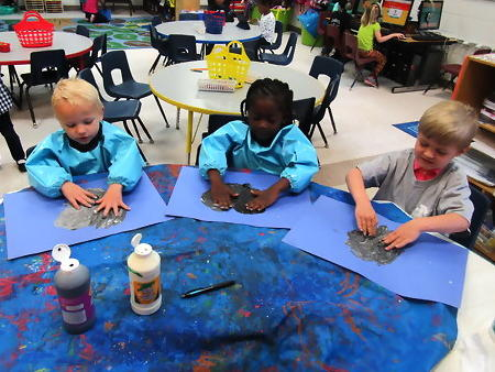 We love painting with our hands!