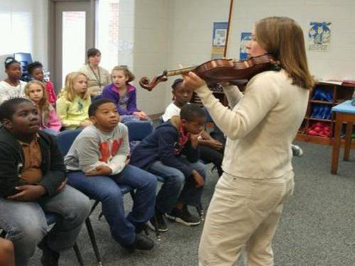 Abigail Thompson, a MCES parent, shares her love of the violin with our 4th  graders.
