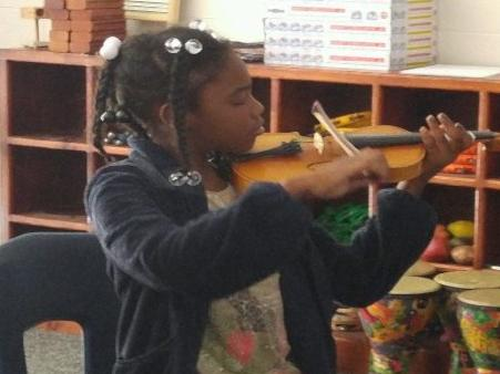 5th grader gives her hand a try at the violin!