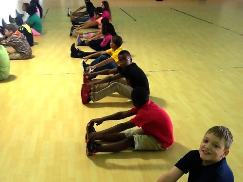 3rd grade stretching before engaging in physical education games