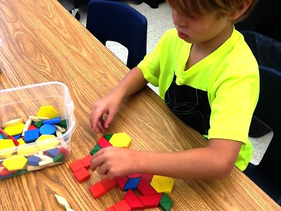 PreK What can you build with tangram blocks? A train?? Why yes I can!