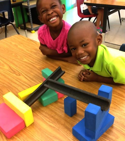 PreK Build a slide for a marble that has one turn and stops at the end! Great  Job!