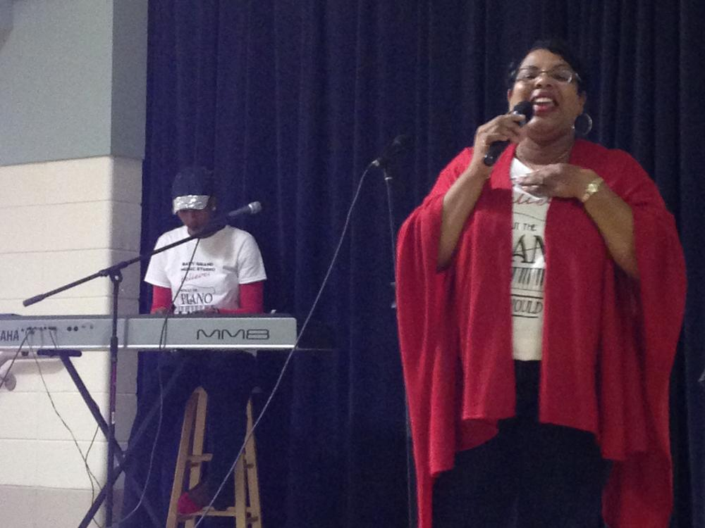 Mrs. Robin Holmes-Lanier of Baby Grand Music Studios delights students with  songs honoring Black History.