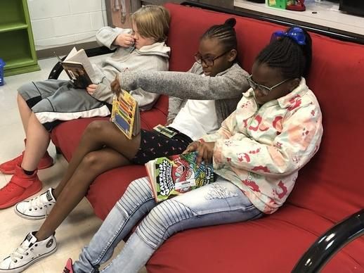 5th grade loves to read on the comfy couch!