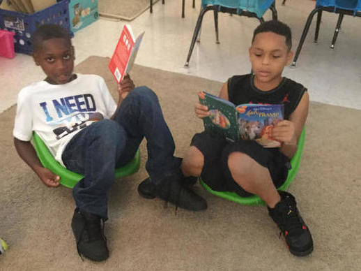 Reading in the comfy lounge chairs!