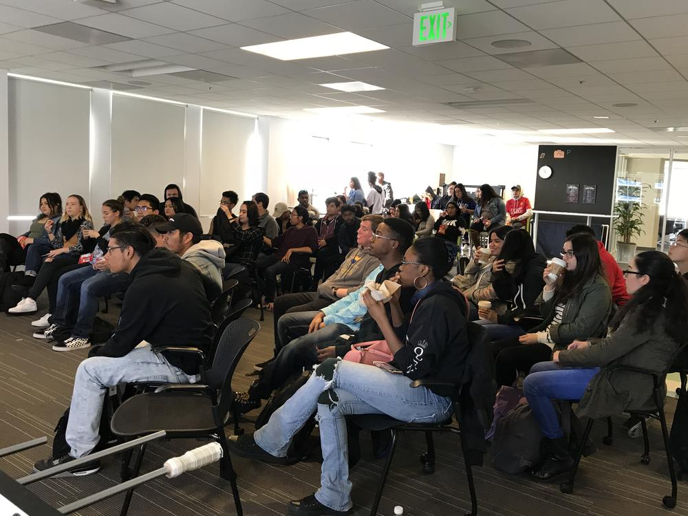 Students listen to presentation on tech careers at Pandora Headquarters.