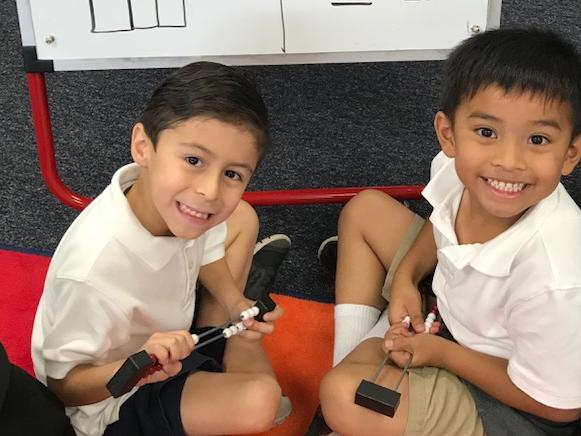 Kinder students ready to their peers