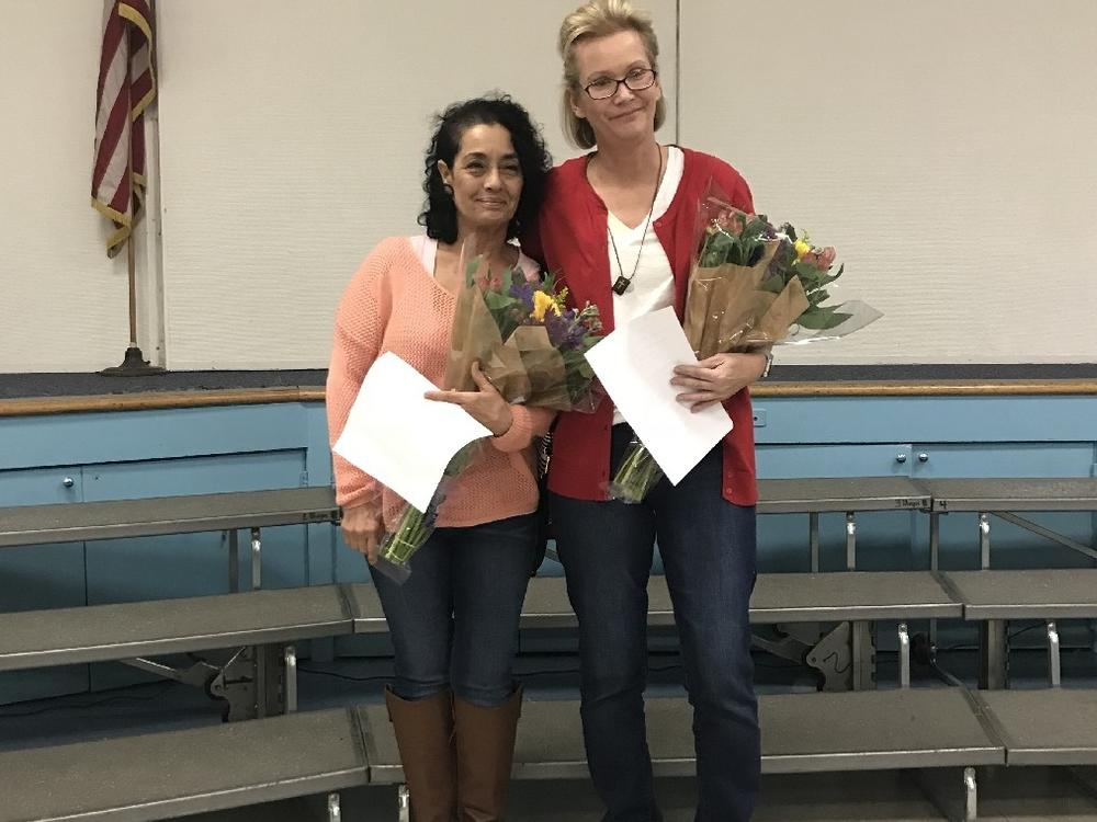 Ms. teresa and ms. addie receiving an award