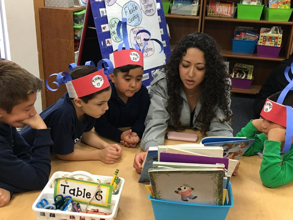 Parent reading to a group of students