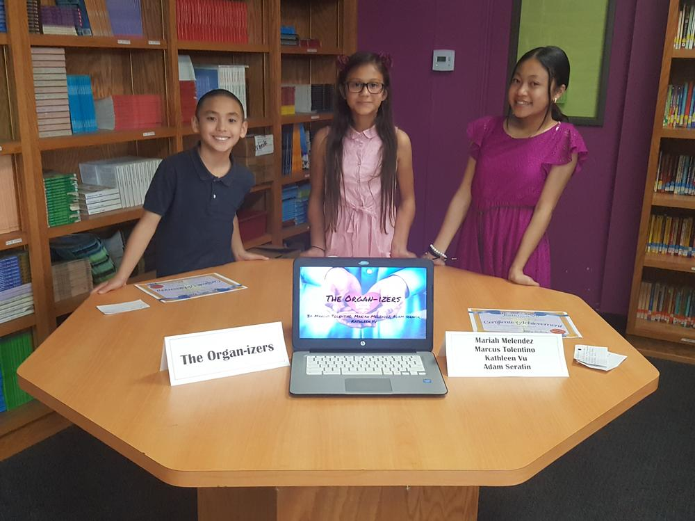 Marcus, Mariah and Kathleen showcasing their project
