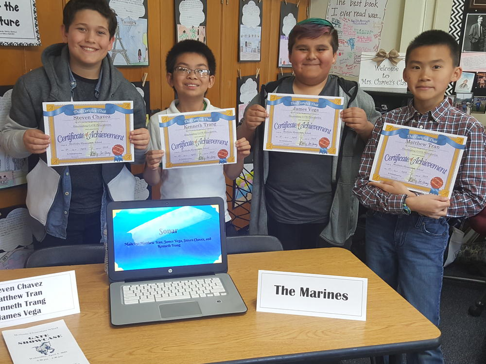 Steven, Matthew, Kenneth and James showcasing their project