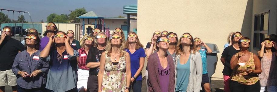 Tachers at Walnut Canyon School looking up at the solar eclipse
