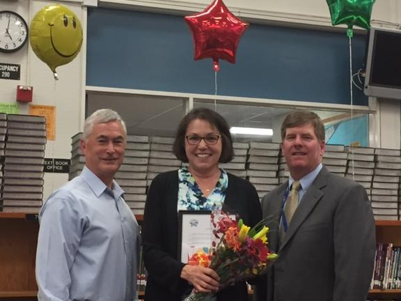 Board member Richard Severy and Superintendent Burns congratulate Rheem  Principal Elaine Frank for 30 years with the district