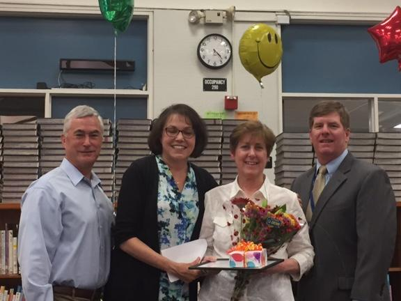 Board member Severy, Principal Frank and Superintendent Burns congratulate  Rheem teacher Joan Caraska for 22 years with the district