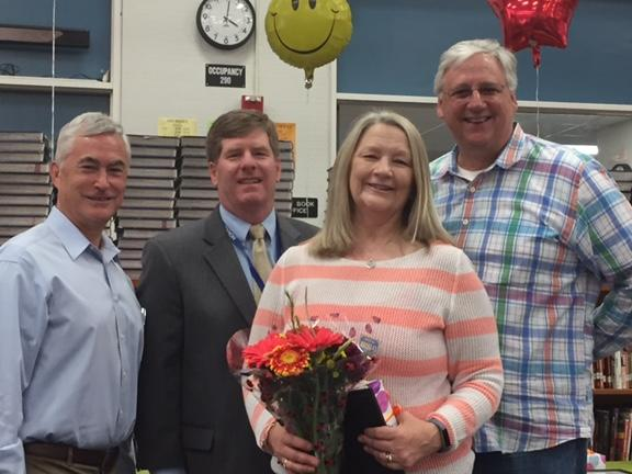 Board member Severy, Superintendent Burns and Principal Tom Rust congratulate  LP secretary Lorie Forshay on 11 years with the district