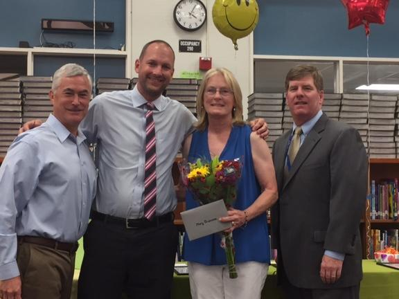 Board member Severy, Principal Chris Reddam and Superintendent Burns  congratulate CP instructional assistant Mary Bruzzone on 15 years with the  district