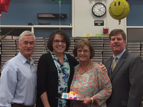 Board member Severy, Principal Elaine Frank and Superintendent Burns  congratulate Rheem instructional assistant Nancy Magdoff on 26 years with the  district