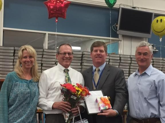 Principal Joan Danilson, Superintendent Burns, Board member Severy congratulate  JM teacher Don Read for 18 years with the district