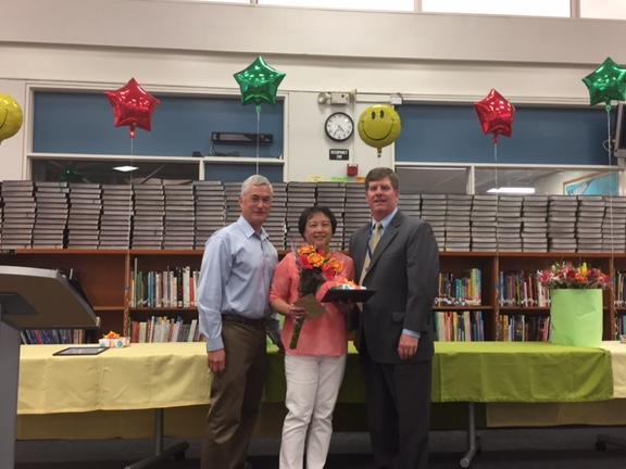 Board member Severy and Superintendent Burns congratulate LP teacher Jeanie  Wieden for 24 years with the district
