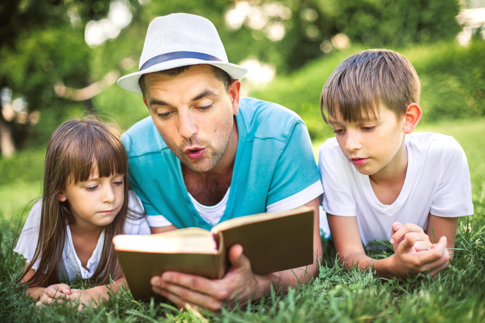 Father Reading to Children Image
