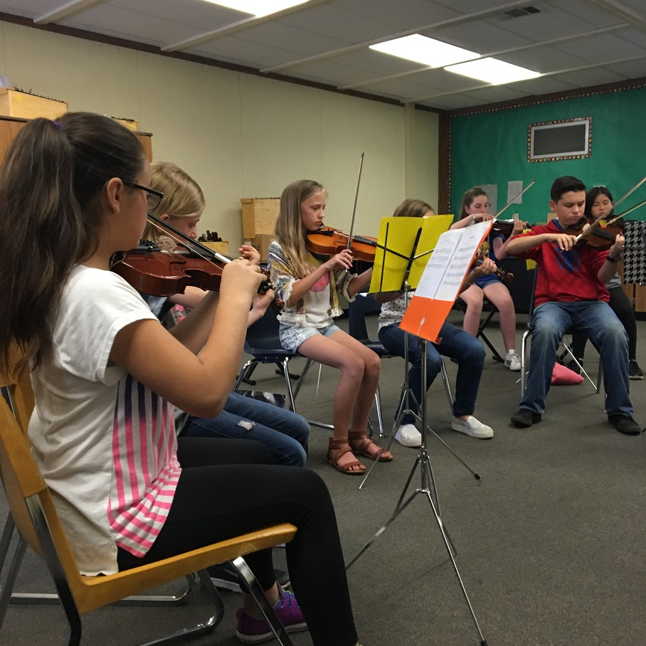 students playing strings