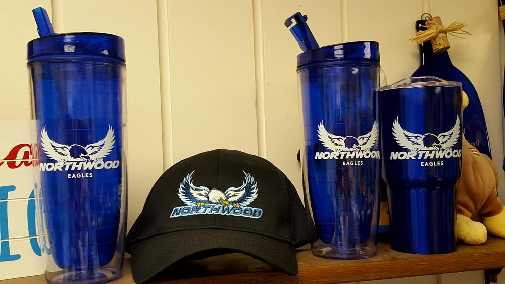 Northwood logo baseball cap, coffee tumbler, and drink cup