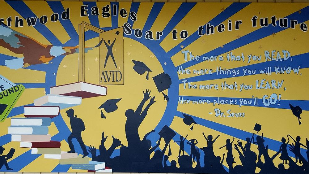avid mural painted by Napa High students, silhouette students throwing  graduation caps with dr seuss quote the more that you read the more things you  will know the more that you learn the more places you ll go
