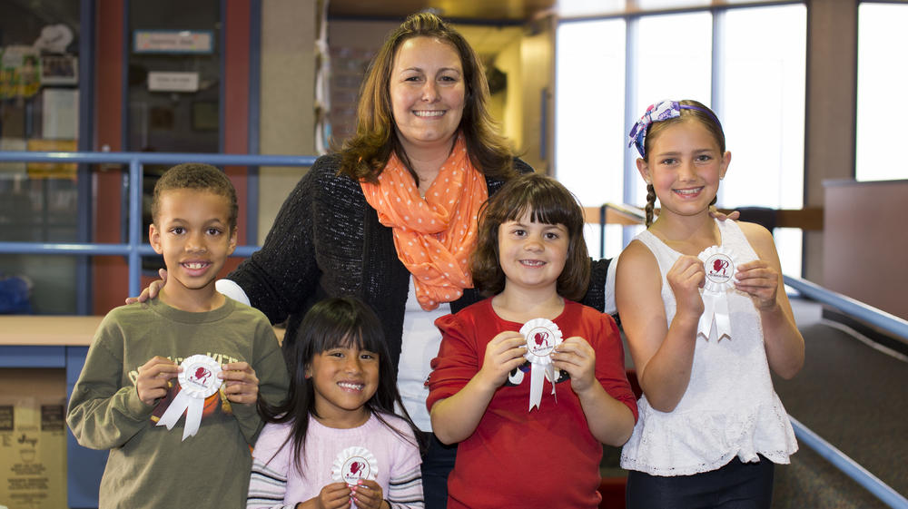 Principal Angela Ryals with three students who have received an award