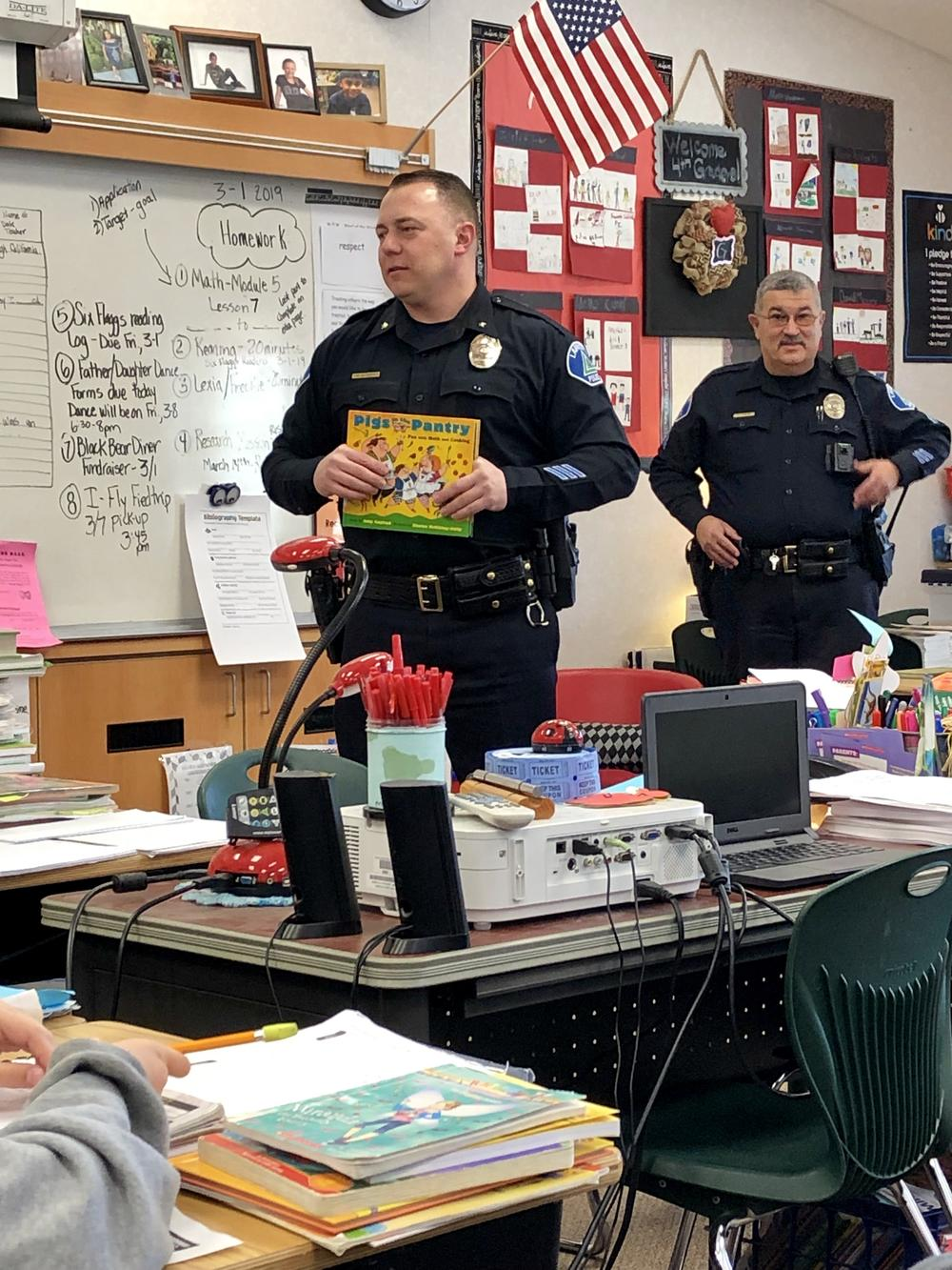 Chief of Police Alldritt reading on Literature Day