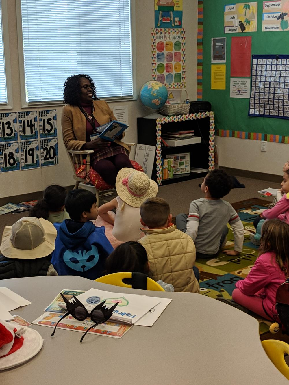 Ms. Brooks reading to Kinder
