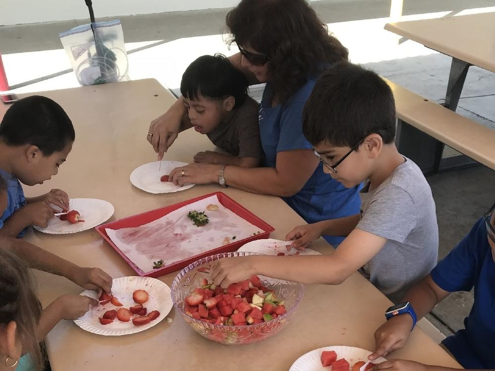 Making a Friendship Salad with our friends from room 17