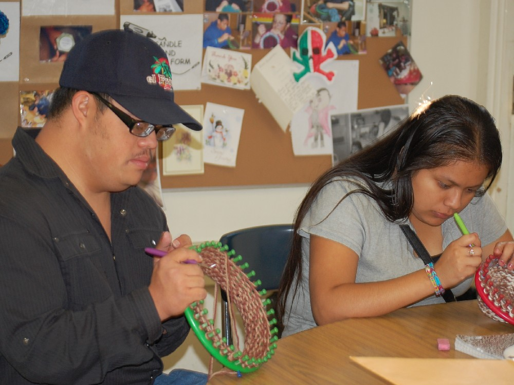 Two Students Making Hats