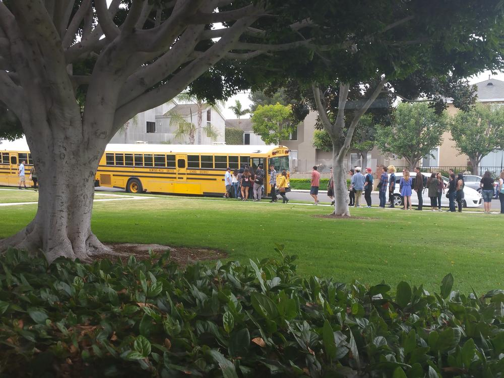 Students getting on bus