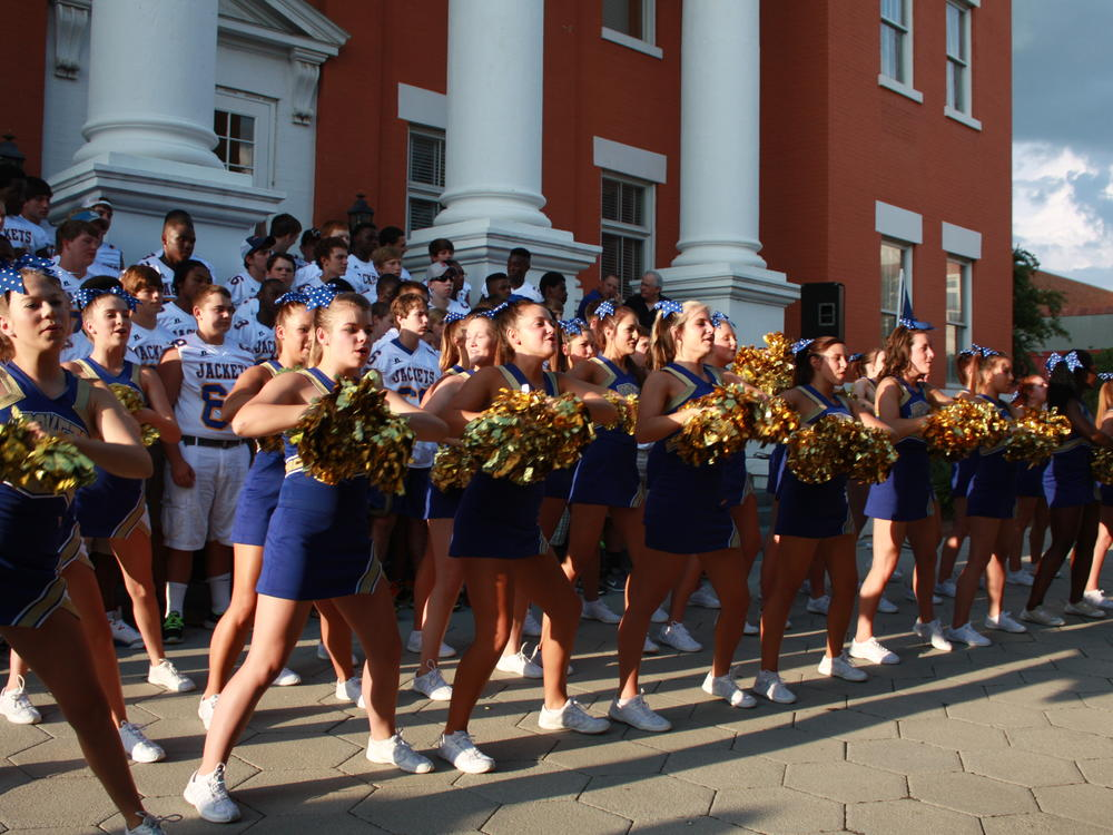 Community-Wide Pep Rally for Football Teams