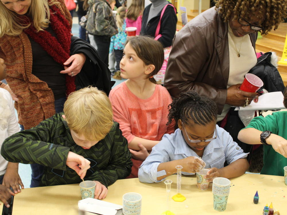 Kids perform experiments during Family Math Science Night