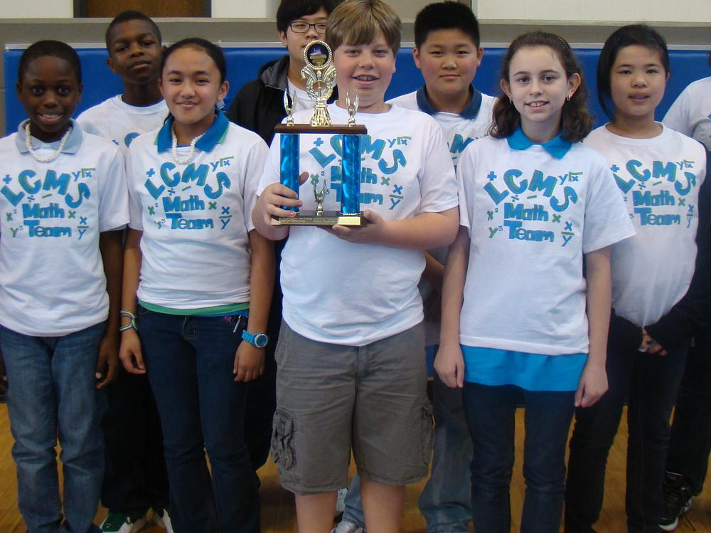 Langston Middle students show off their winning trophy during Penny Sikes Math  Tournament
