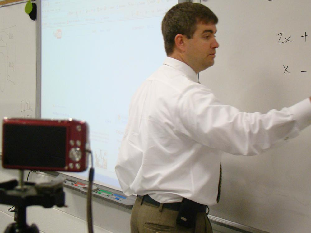 Teacher films lessons for upload to YouTube for students