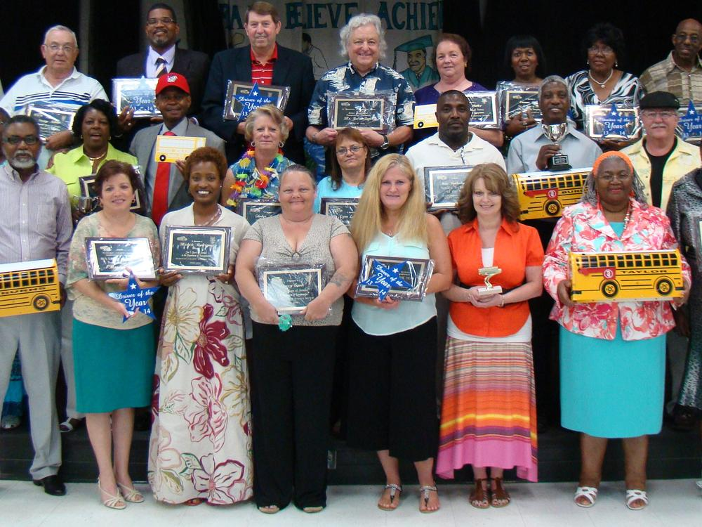Bus drivers and bus monitors receive awards.